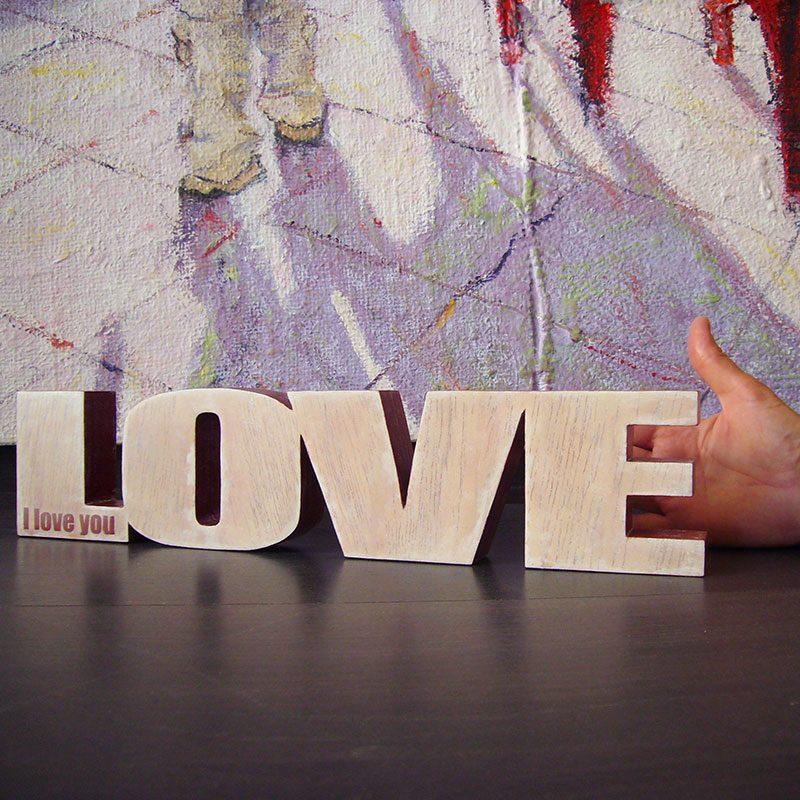 love de madera pintado y grabado