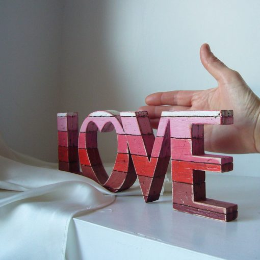 love decorativo original de madera