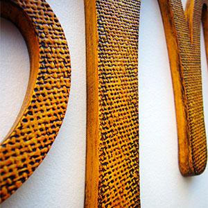 iniciales-yute-naranja Galería 7